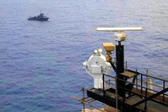 View of ocean vessel and waterside security equipment from harbor